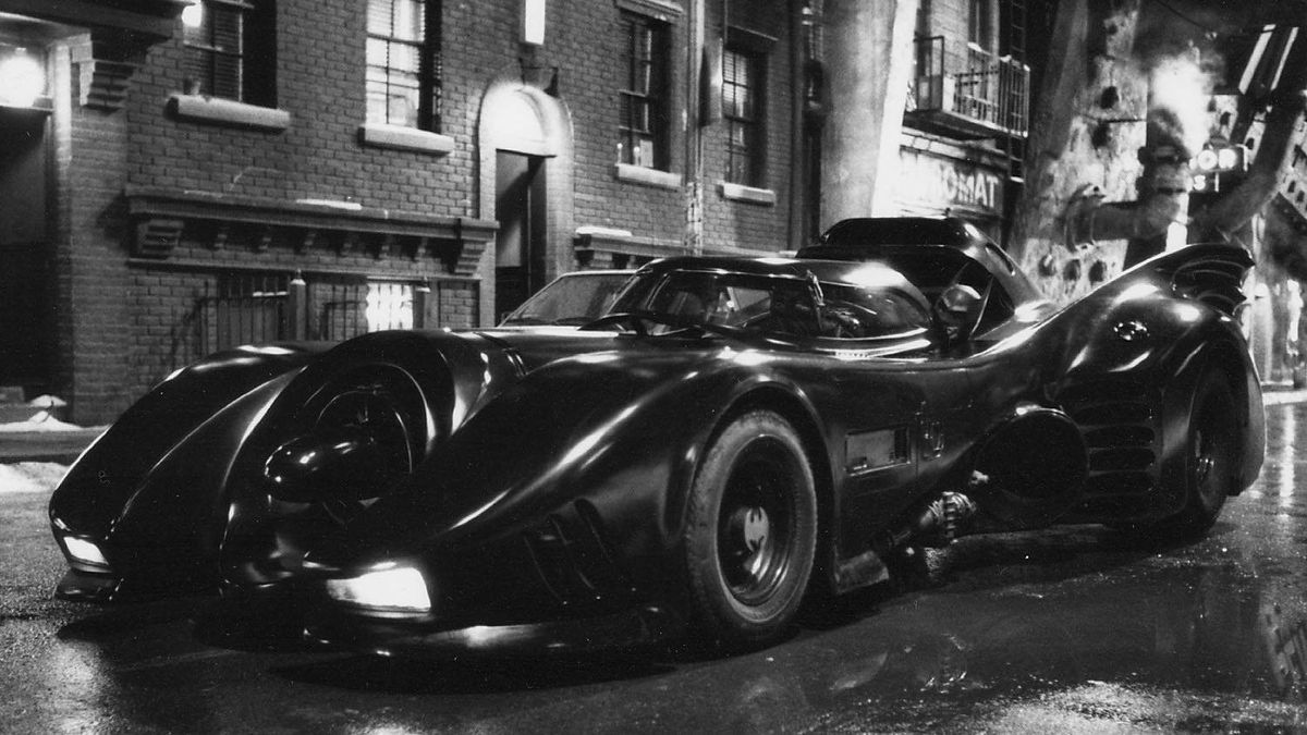 """Returning to help Batman fight crime in Gotham City is the sleek and powerful Batmobile in """"Batman Returns"""" starring Michael Keaton, which was released in 1992."""