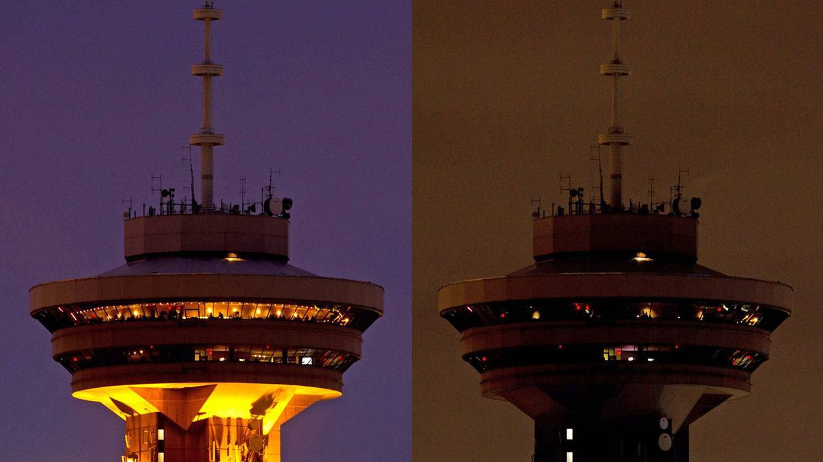 Vancouver's Harbour Centre tower is pictured before and during Earth Hour on March 31, 2012. The annual event, in which people around the world turn off their lights to reduce energy consumption, is meant to bring awareness to climate change.