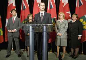 Ontario Premier Dalton McGuinty speaks in front of new cabinet ministers Eric Hoskins, Sophie Aggelonitis, Linda Jeffrey and Carol Mitchell after their swearing in ceremony at Queen's Park on Monday January 18, 2010.