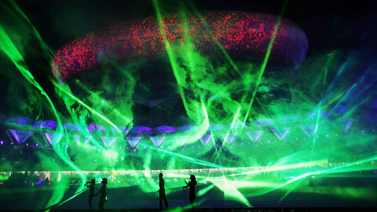 Dancers perform during the Closing Ceremony for the Delhi 2010 Commonwealth Games at Jawaharlal Nehru Stadium.