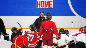 Head Coach Steve Leslie speaks with his Bantam House players during practice at Cole Harbour Place in Cole Harbour, N.S., Jan. 4, 2011.