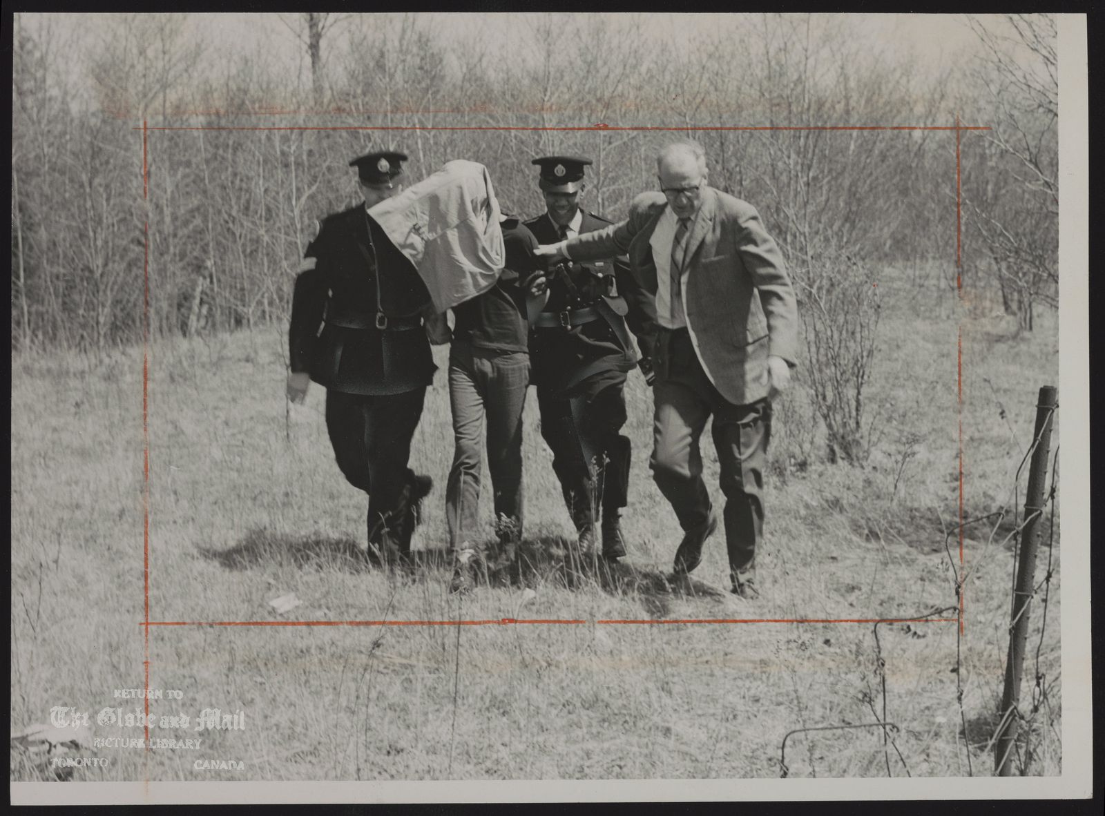Philip DUMAS Scarboro. Charged with non Capital murder THE END OF A POLICE MANHUNT Out of a Scarborough bush, police bring the youth they arrested yesterday after a 23-year-old woman teacher was found stabed and strangled. Constable Larry McLarty (middle) made the arrest, Flanking him are Sgt. Kenneth Haddon (left) and Det.Sgt. Harold Roberts, Philip Dumas, 17, has been charged with capital murder.
