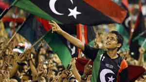 Libyan revolutionary supporters react as Libyan Transitional National Council chairman Mustafa Abdel Jalil delivers his speech on the former Green Square renamed as Martyr's Square inTripoli, Libya, Monday, Sept. 12, 2011.