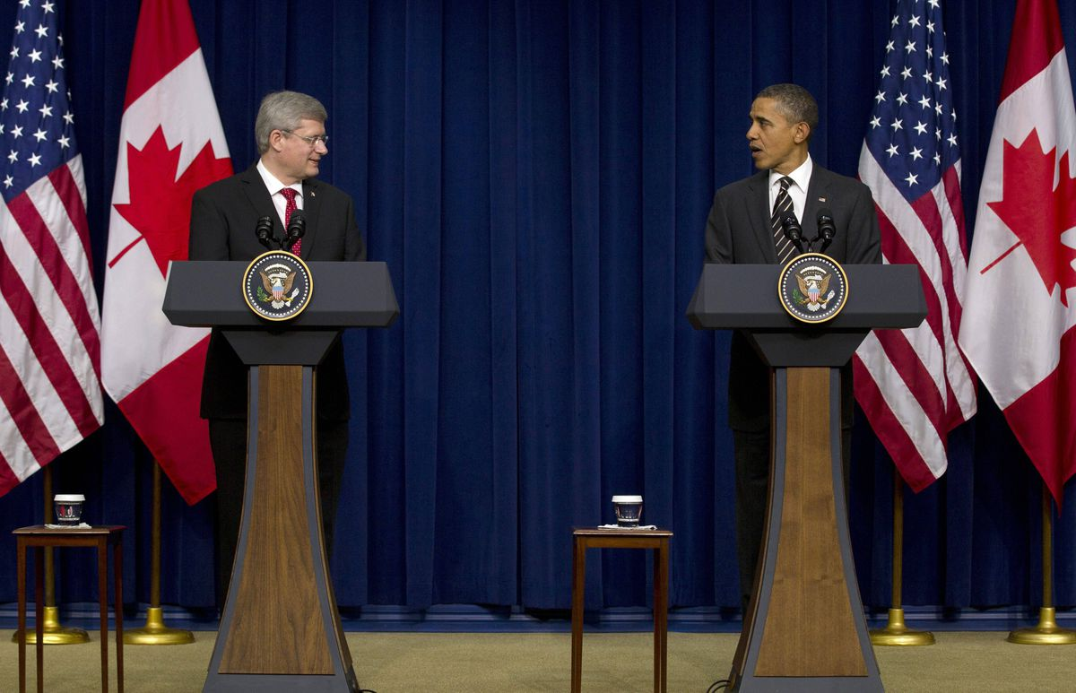 President Barack Obama and Canadian Prime Minister Stephen Harper speak in the South Court Auditorium on the White House complex in Washington, Wednesday, Dec. 7, 2011.