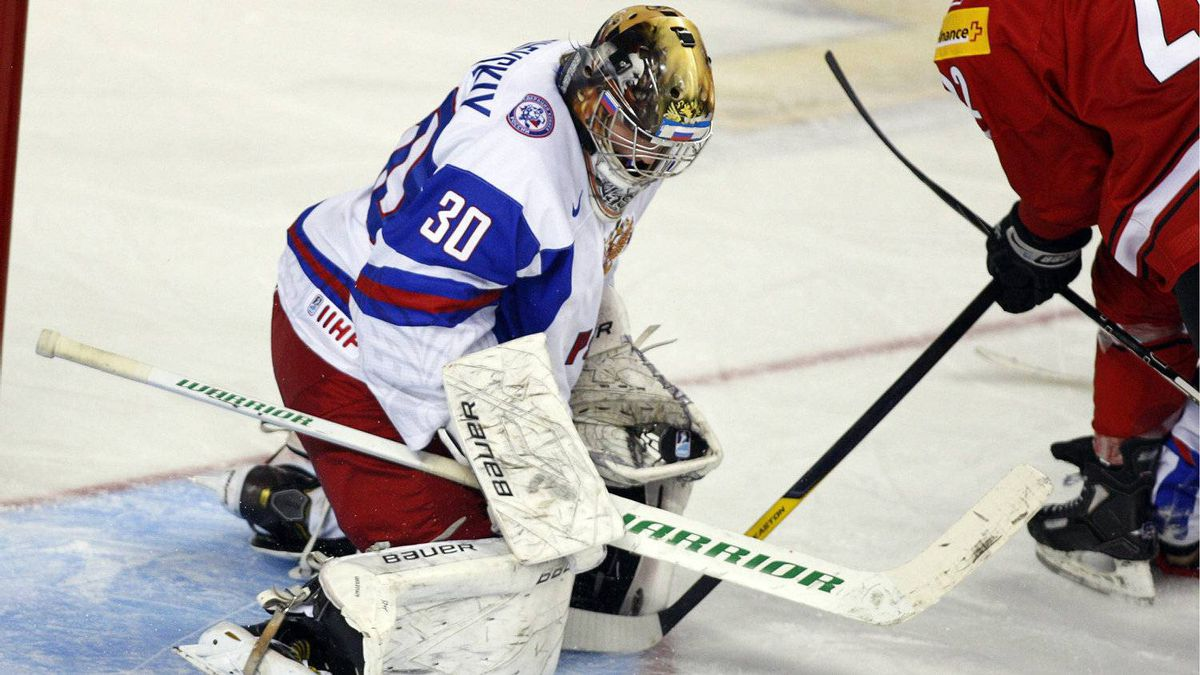 Team Russia's goalie Andrei Vasilevski traps the puck on a shot from Switzerland's Sven Andrighetto during the third period of their game in the World Junior Championships Dec. 26, 2011. Russia beat the Swiss 3-0