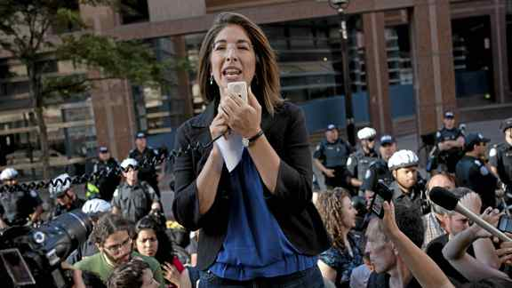 Writer Naomi Klein addresses the crowd as hundreds of demonstrators gather outside Toronto Police Headquarters on Monday June 28, 2010 to protest against tactics used by the police during G20 protests over the weekend.