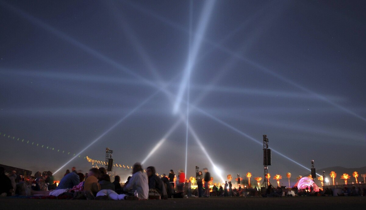 Lights crisscross the sky over the 2012 Coachella Valley Music and Arts Festival in Indio, California.