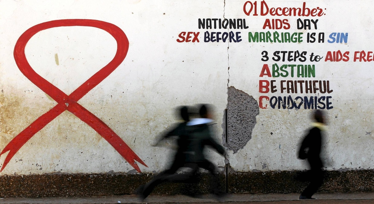 Children run past a mural painting of an Aids ribbon at a school in Khutsong Township, 74 km west of Johannesburg, Aug. 22, 2011.