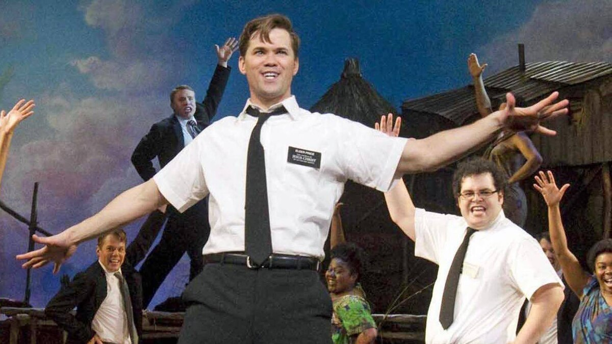 In this publicity image released by Boneau/Bryan-Brown, Andrew Rannells performs with an ensemble cast in The Book of Mormon at the Eugene O'Neill Theatre in New York.