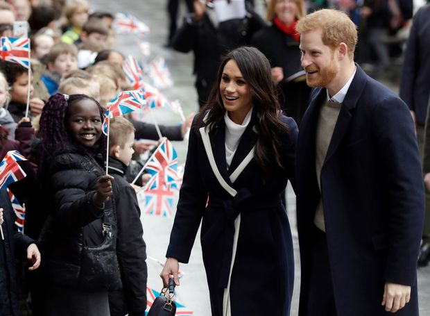 Britain S Prince Harry And His Fiance Meghan Markle Are Greeted By Flag Waving Schoolchildren As They Arrive To Take Part In An Event For Young Women