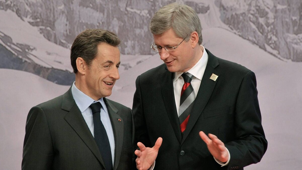 Nicolas Sarkozy, left, French President, speaks with Canadian Prime Minister Stephen Harper prior to the group photo at the Francophonie Summit in Montreux, Switzerland, Saturday, Oct. 23, 2010.