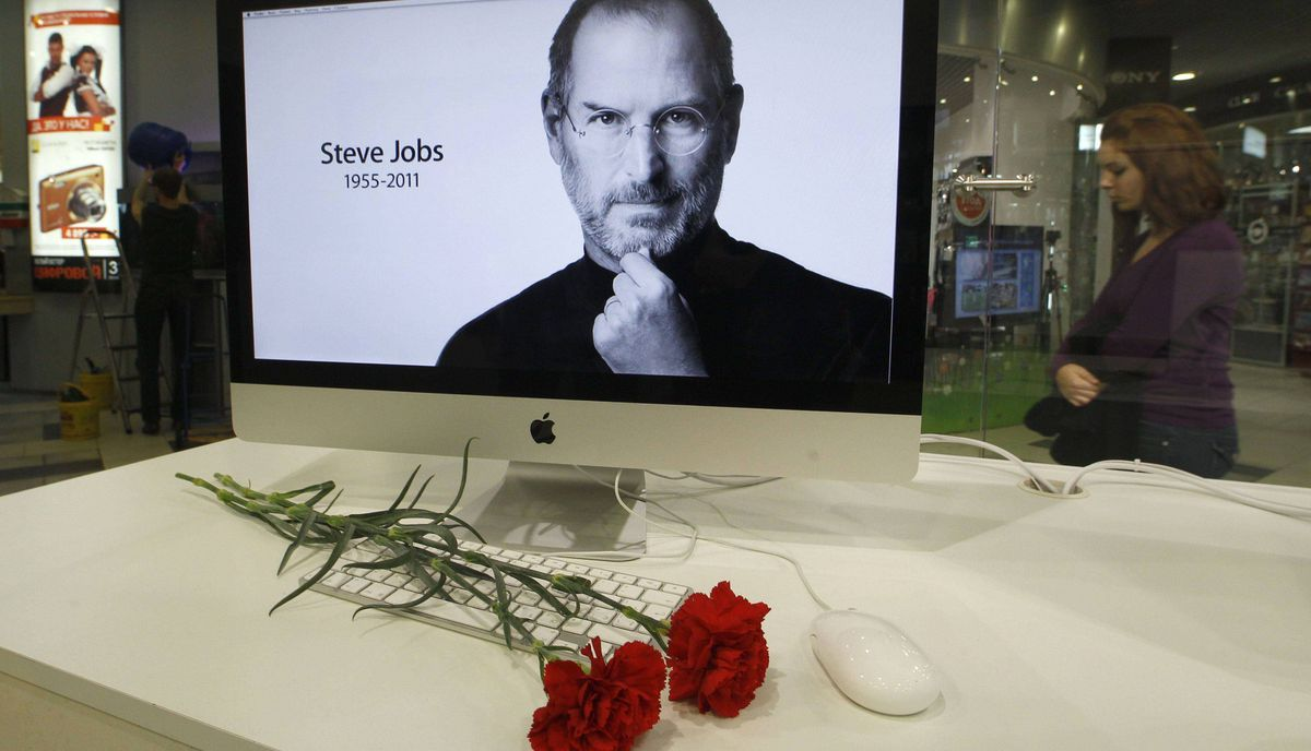 Carnations are placed before a computer screen showing a portrait of Apple co-founder and former CEO Steve Jobs at an Apple store in St. Petersburg, Russia October 6, 2011.