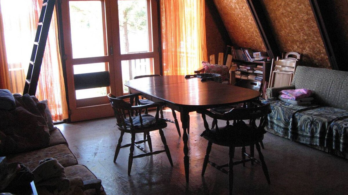 Another view of the living and dining area of the cottage.