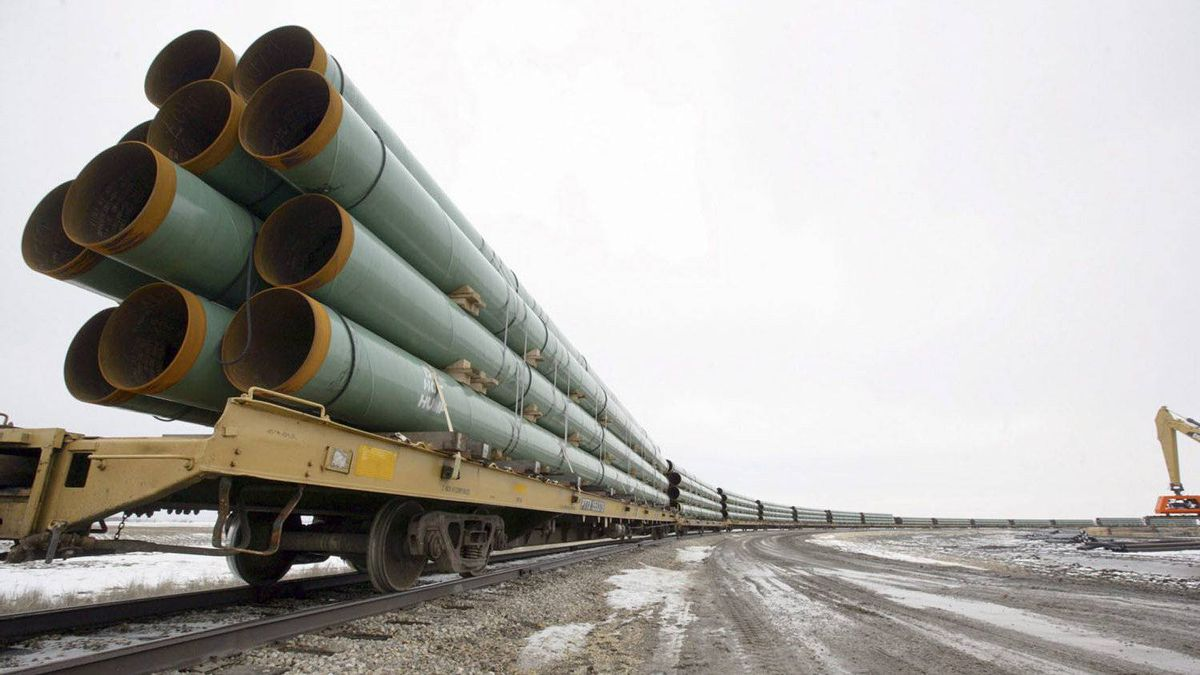 In this Feb. 28, 2008 file photo, rail cars arrive in Milton, N.D., loaded with pipe for the Keystone Pipeline project.