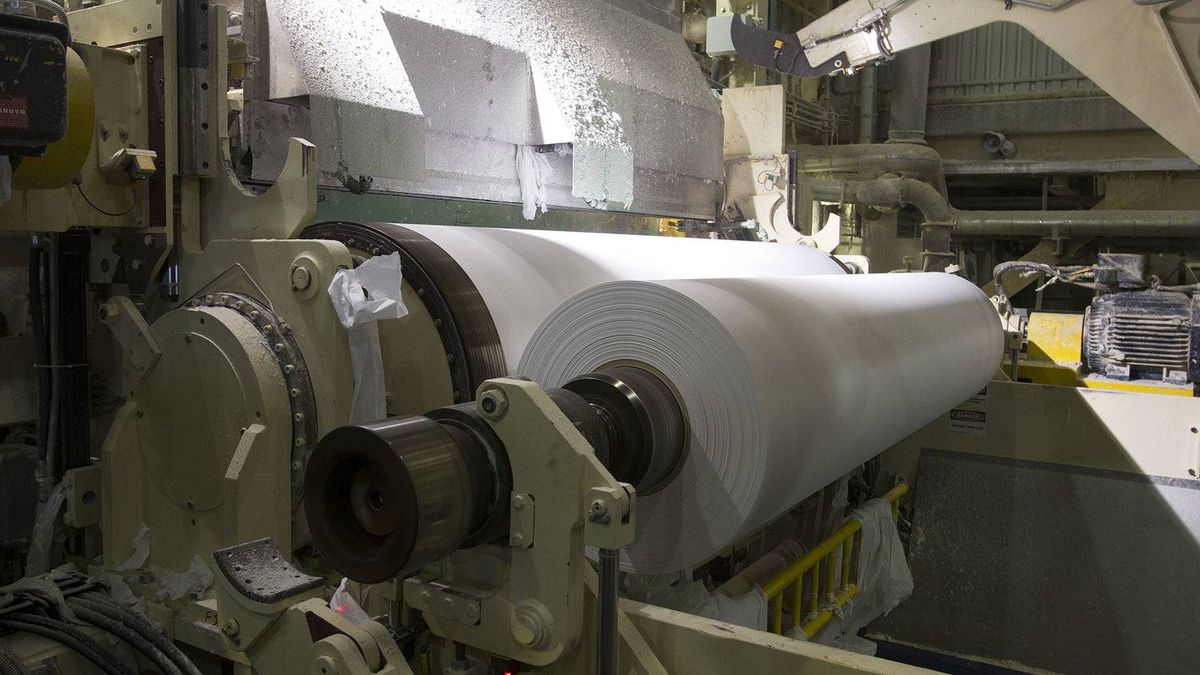 Tissue being rolled at Cascades Tissue Group plant, in Candiac. The company expects strong financial results over the next few years.