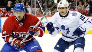 Tomas Plekanec #14 of the Montreal Canadiens and Matthew Lombardi #15 of the Toronto Maple Leafs chase the puck during the NHL game at the Bell Centre on October 22, 2011 in Montreal, Quebec, Canada. The Leafs won 5-4 in overtime. (Photo by Richard Wolowicz/Getty Images)