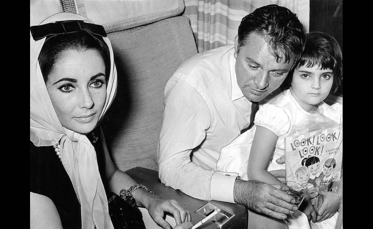 Elizabeth Taylor with Richard Burton and her daughter Liza at Malton, Sept. 22, 1963.
