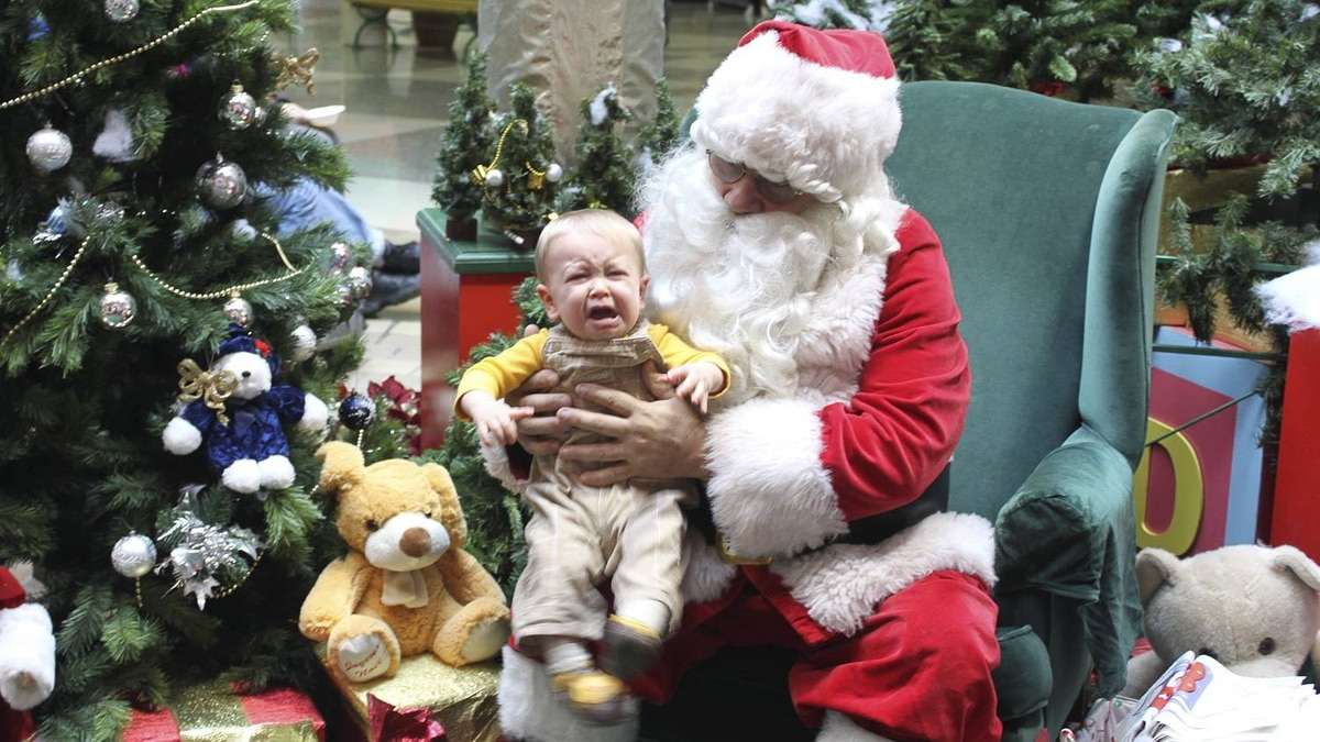 Dan Honsinger photo: Aiden Meets Santa - The Santa at The Parry Sound Mall was a jolly fellow, but Aiden (10 months) didn't agree.