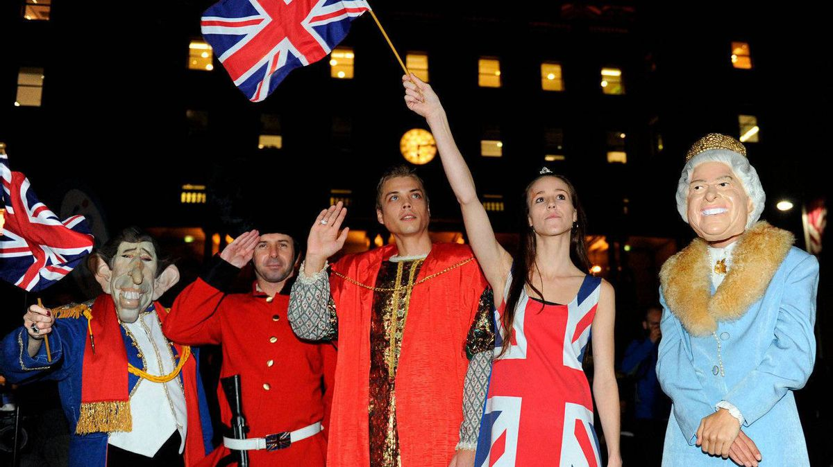 Sydneysiders in fancy dress watch the royal wedding in London of Prince William and Catherine Middleton on a public screen in Sydney on April 29, 2011.