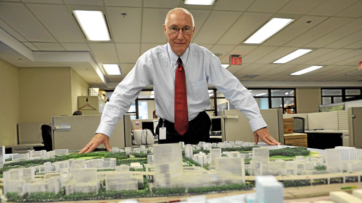 John Campbell, head of Waterfront Toronto, looks over a model proposal for the lower Donlands in his Toronto office on Thursday.