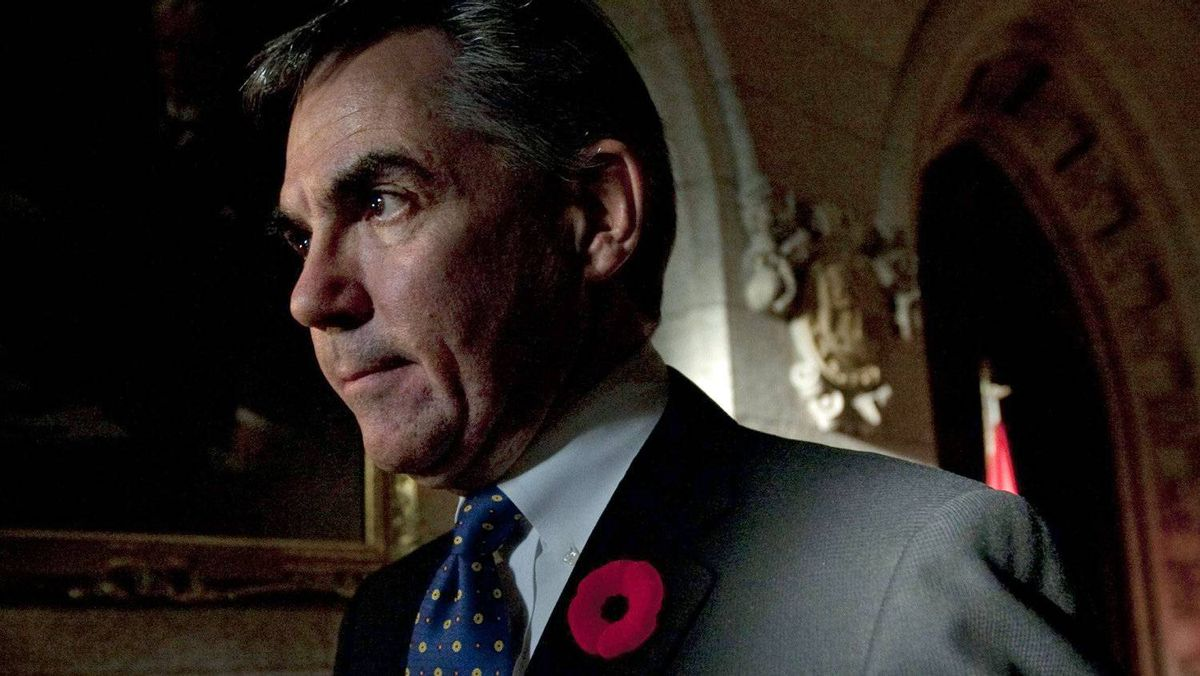Environment Minister Jim Prentice leaves a hastily called news conference in the foyer of the House of Commons on Nov. 2, 2010.