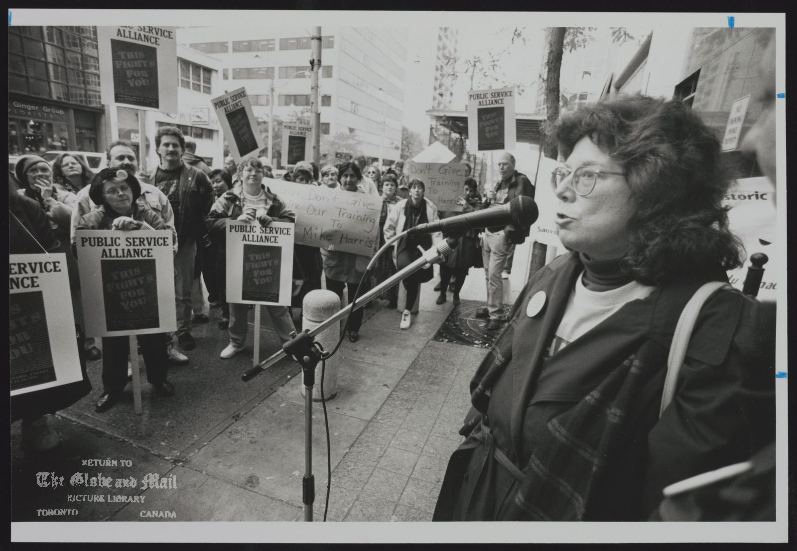 The notes transcribed from the back of this photograph are as follows: LABOUR LEADER LINDA TORNEY SPEAKS AT A RALLY IN TORONTO, A WARNING FOR THE DAYS OF ACTION PROTEST TAKING PLACE IN THE CITY OVER THE NEXT TWO DAYS.