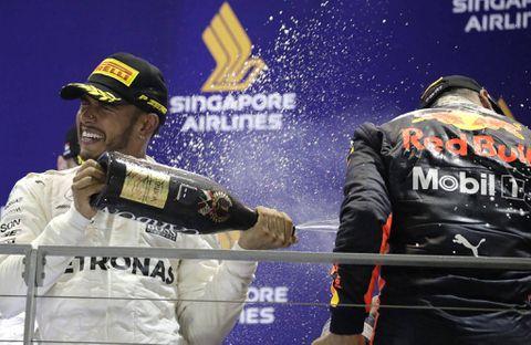 Formula One: Hamilton profits from Vettel crash to win Singapore Grand Prix