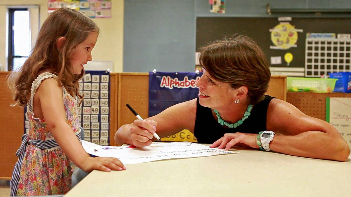 Millie Bolton works on language skills with Westminster Public School principal Lillian Lahe. Millie will be attending the full-day senior kindergarten program this year.