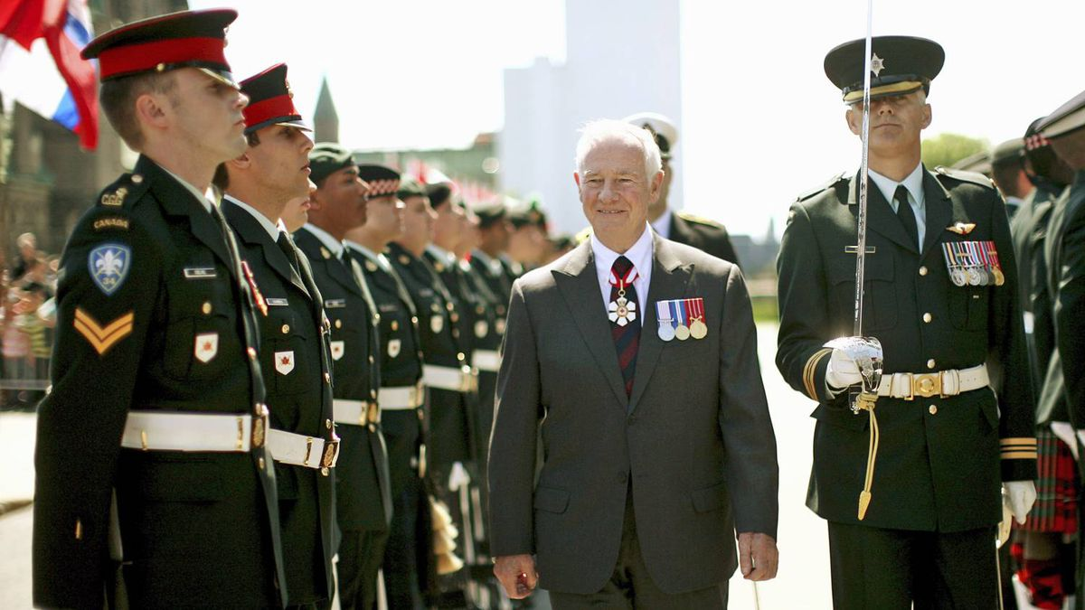 Governor-General David Johnston inspects an honour guard prior to delivering the Speech from the Throne in Ottawa on June 3, 2011.