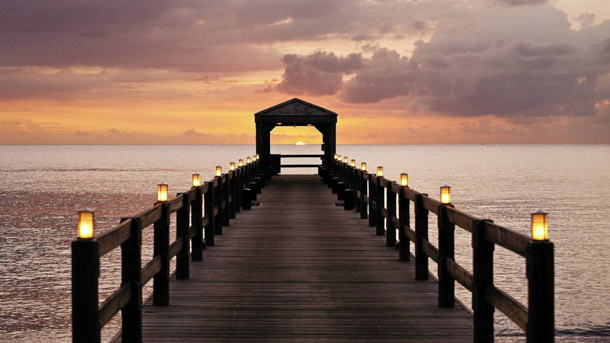 Watch the sun go down from the jetty at the Four Seasons Resort on Nevis.