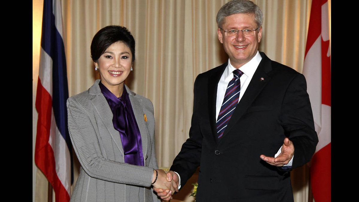 Prime Minister Stephen Harper shakes hands with Thailand's Prime Minister Yingluck Shinawatra during a meeting at Government House in Bangkok on March 23, 2012.