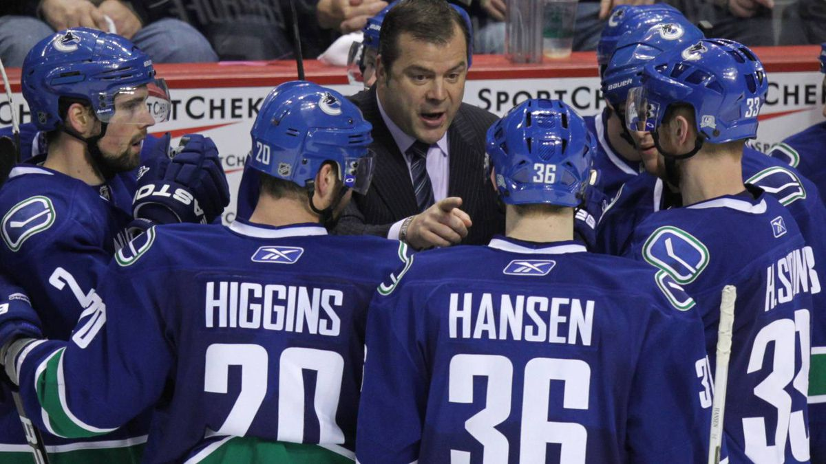 Vancouver Canucks Head coach Alain Vigneault talks to his team during a time out in the third period in game one of the NHL Western Conference semifinal Stanley Cup playoff hockey series in Vancouver April 28, 2011.