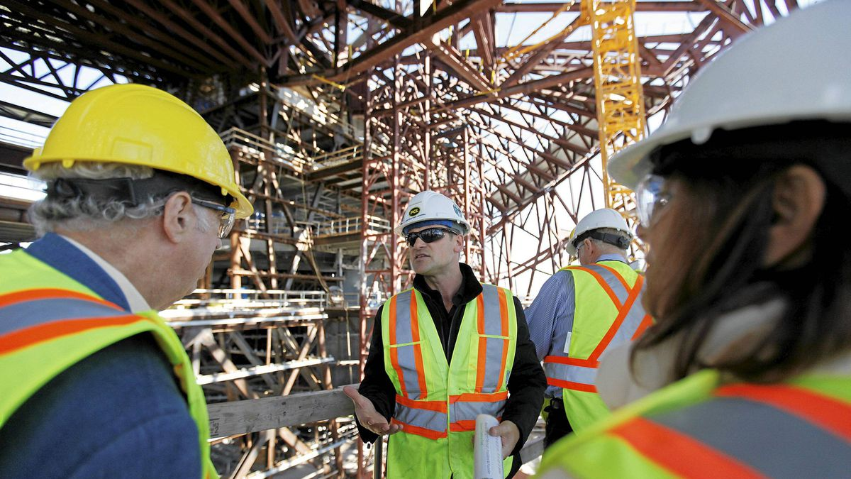 PCL project manager Jon Kindrachuck leads a tour of the Canadian Museum of Human Rights construction site in Winnipeg on Monday.