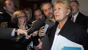 Parti Québécois Leader Pauline Marois responds to reporters' questions as she leaves a special party caucus meeting at the legislature in Quebec City on Oct. 26, 2011.