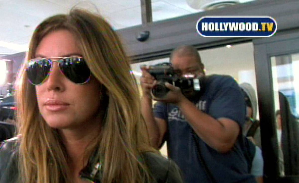 """This video frame grab, provided by Hollywood TV, shows Rachel Uchitel at Los Angeles International Airport Nov. 29, 2009. Ms. Uchitel denied tabloid reports she had had a """"jet-set liaison"""" with Tiger Woods."""