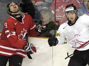 Team Canada's Nazem Kadri, left, reacts after being elbowed by Team Switzerland's Dominik Schlumpf during third period semifinal world junior hockey championship action in Saskatoon, Sask., Sunday, Jan. 3, 2010. Team Canada won by 6-1. THE CANADIAN PRESS/Geoff Howe
