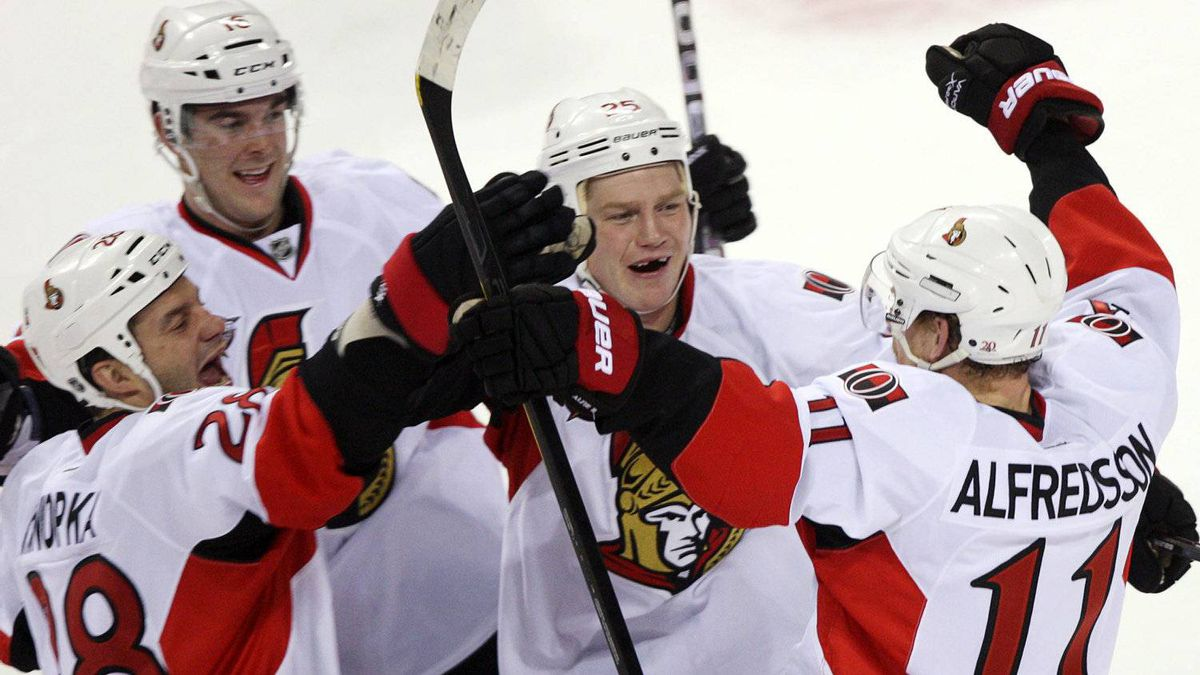 Ottawa Senators right wing Daniel Alfredsson (11) celebrates with teammates after scoring the winning goal during the overtime shootout for a 3-2 win over the Montreal Canadiens in National Hockey League action Saturday, January 14, 2012 in Montreal.THE CANADIAN PRESS/Ryan Remiorz