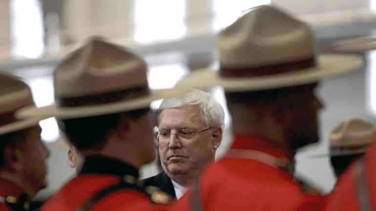RCMP Commissioner William Elliott inspects an honour guard during a change of command ceremony in Vancouver, B.C., on Friday February 11, 2011.