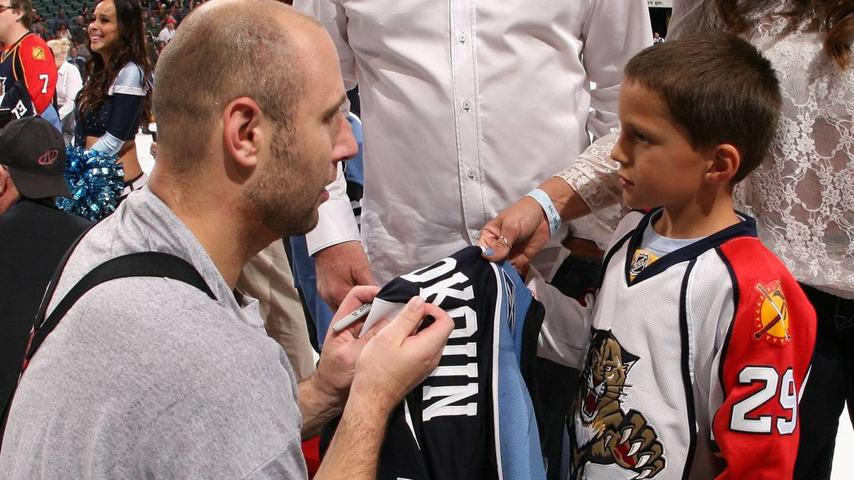 Goaltender Tomas Vokoun #29 of the Florida Panthers signs his jersey for a young fan after it was won on auction after the game against the Washington Capitals on April 9, 2011 at the BankAtlantic Center in Sunrise, Florida. The Panthers defeated the Capitals 1-0. (Photo by Joel Auerbach/Getty Images)