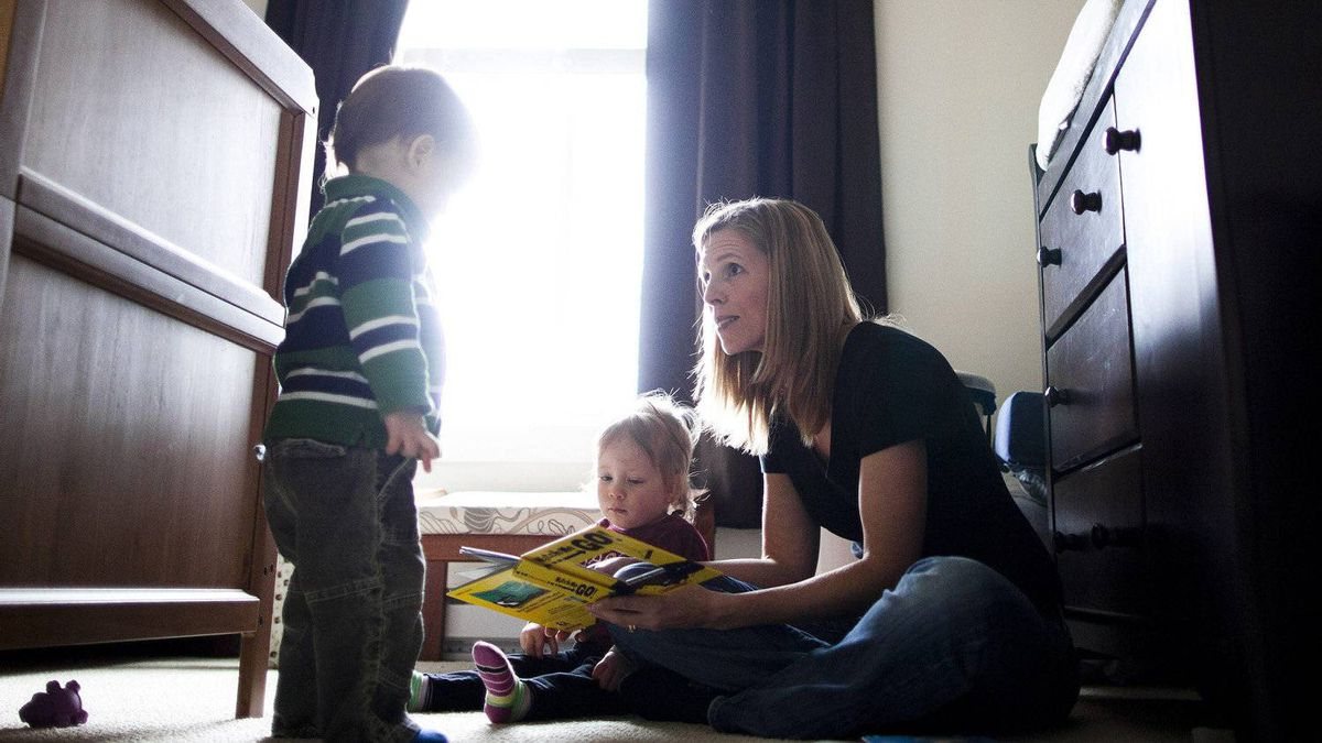 Amy Beeman reads with her 18-month old twin son and daughter, Sam(left) and Lucy(right), at their home in Vancouver, British Columbia, Wednesday, Feb. 8, 2012.