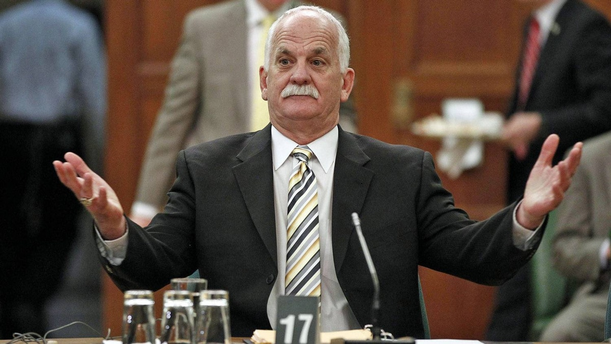 Public Safety Minister Vic Toews waits to testify before the procedure and House affairs committee in Ottawa on March 27, 2012.