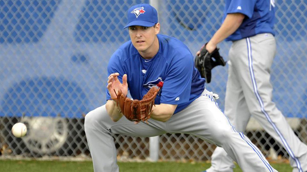 Toronto Blue Jays infielder Kelly Johnson catches a ground ball during practice at their spring training facility in Dunedin, Fla., on Thursday.