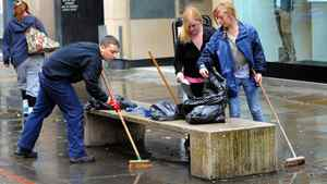 Members of the public help clean up Manchester, England, on Aug. 10, 2011, following a night of violence that occurred during Britain's worst riots in decades.