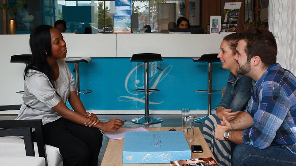 LUXE wedding planner sits down with clients at Liberty Village office in Toronto, Ontario