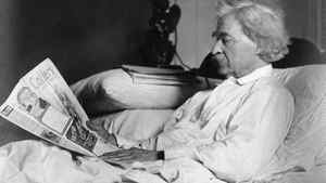 Mark Twain reading in bed