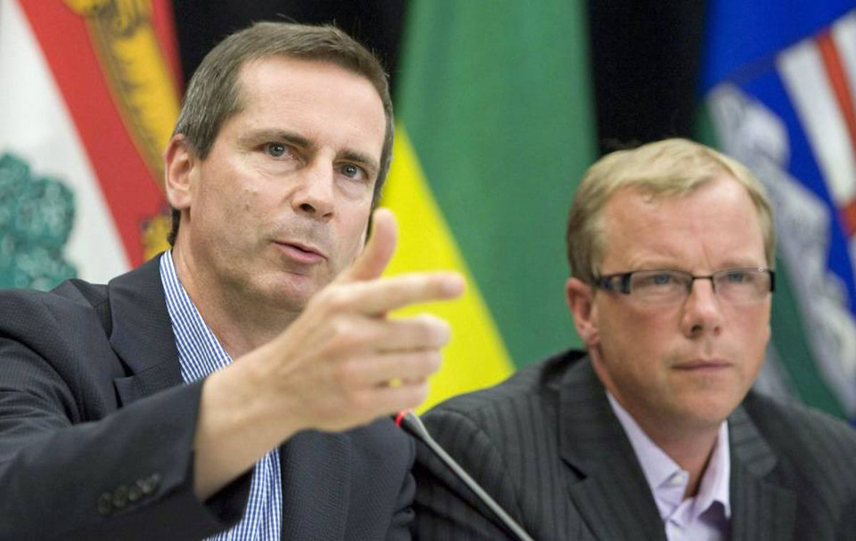 Ontario Premier Dalton McGuinty and his Saskatchewan counterpart Brad Wall speak to reporters after a Council of the Federation meeting in Regina on Aug. 7, 2009.