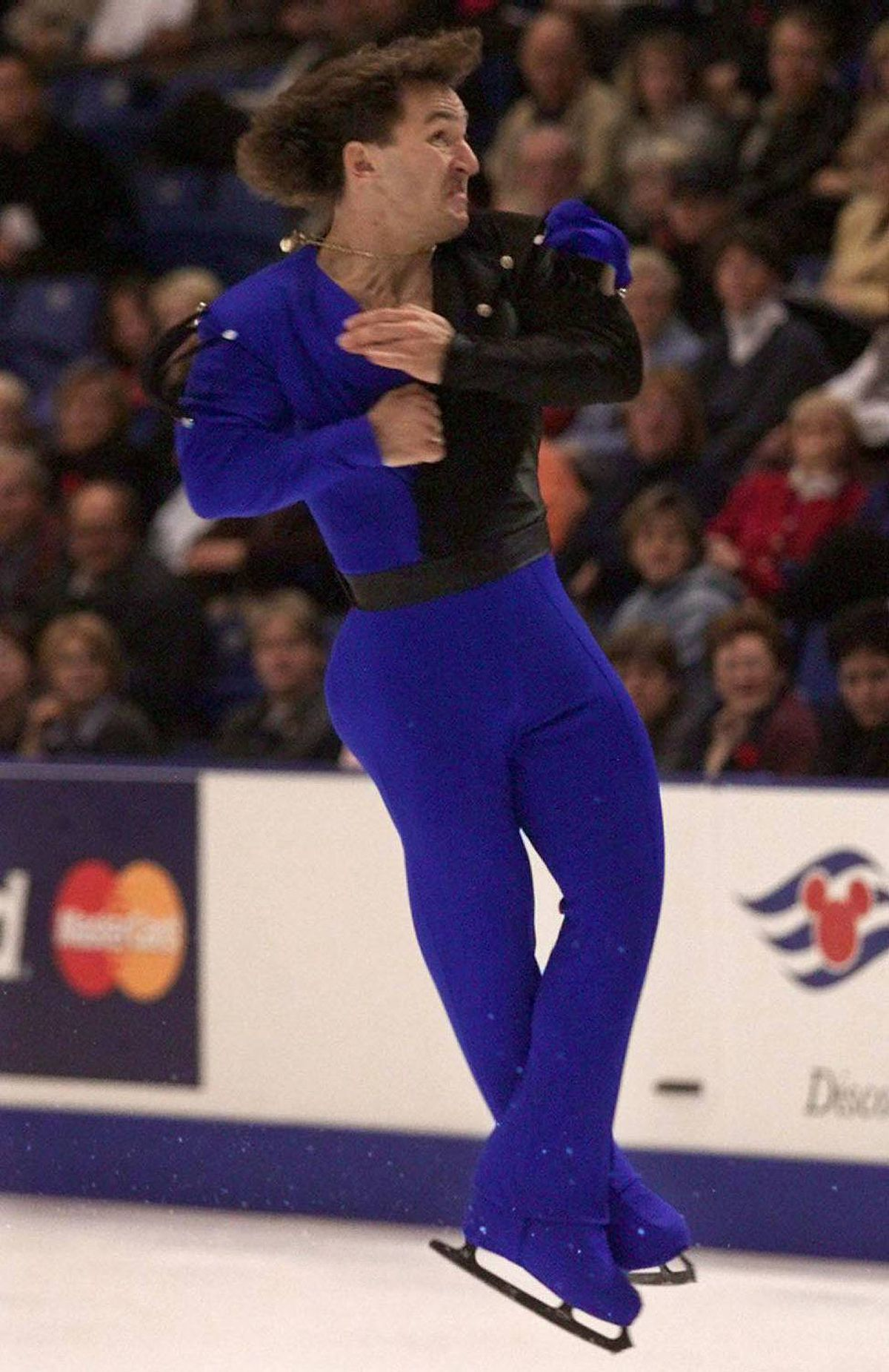 Elvis Stojko jumps during the men's short program event at Skate Canada in Saint John, N.B. on Thursday, Nov. 4,1999.