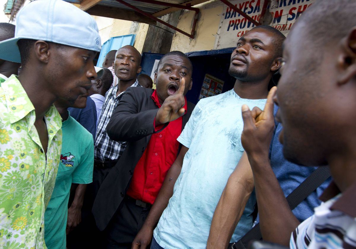 A group of men have a heated discussion in downtown Monrovia, Liberia after the verdict as announced in the case against former Liberian President Charles Taylor.