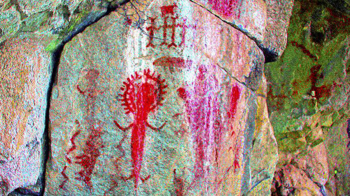 Twin Bays along the eastern shore of Kootenay Lake, B.C.: Accessible only by water, this site contains exceptionally vibrant Columbia Plateau rock art. Several motifs are shown, including a rayed arc and water spirits, such as a frog, salamander and muskrat. Small mountain goats are also depicted, indicating this was an important hunting area.