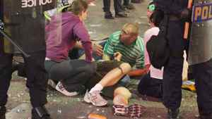 An injured rioter lays on the ground in downtown Vancouver June 15, 2011.